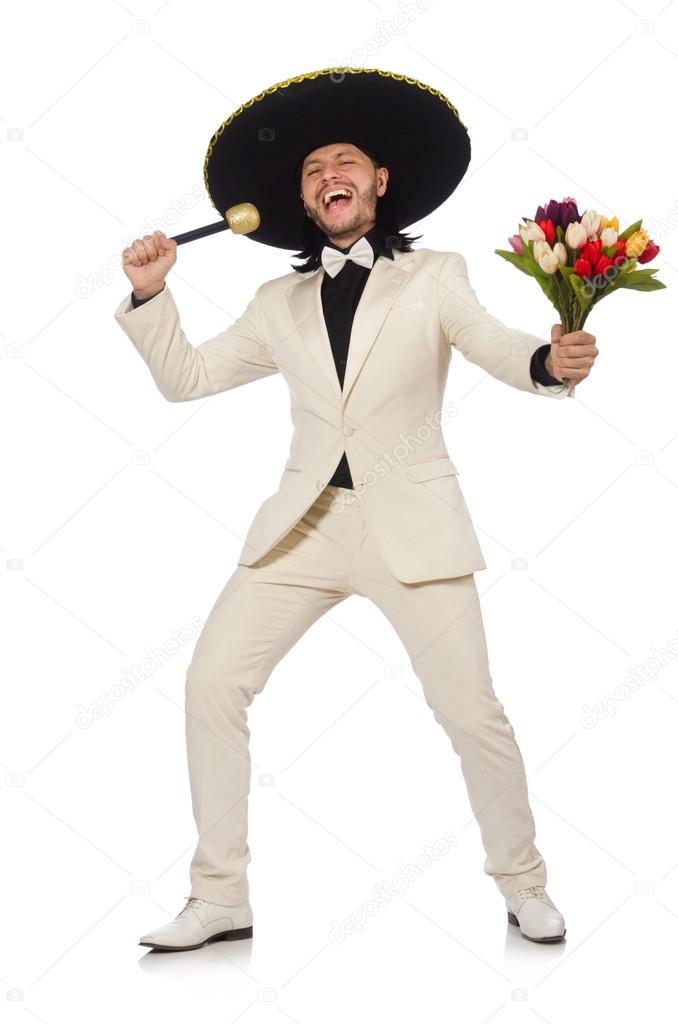 Funny mexican in suit holding flowers isolated on white