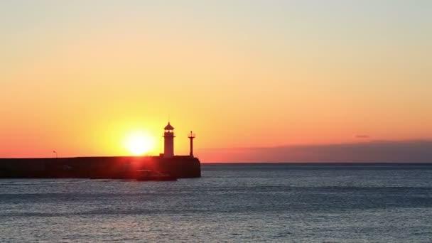 Sunrise against a beacon in Yalta