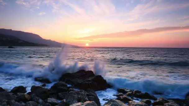 Waves break about stones