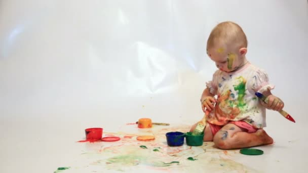Baby painting with brushes