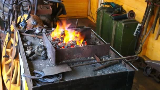 Coals with fire in smithy