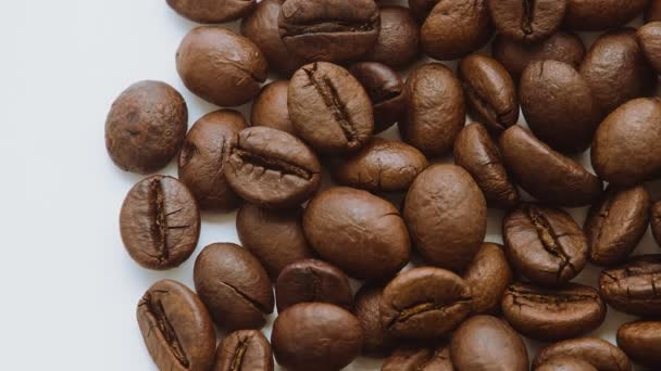 Roasted coffee beans rotating.