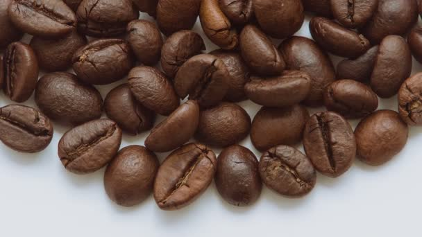 Roasted coffee beans rotating