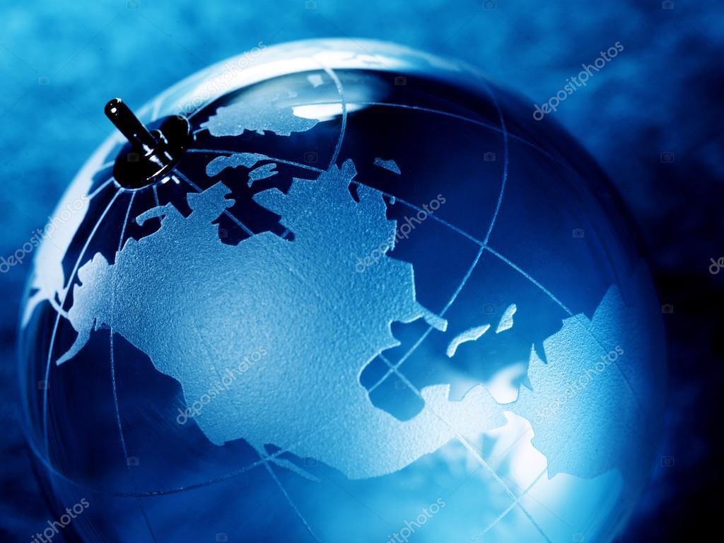 Bola de cristal con mapa del mundo fotos de stock irochka 71023565 glass ball with a picture of a world map on vintage paper background foto de irochka gumiabroncs Images