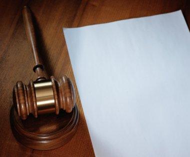 Judge gavel and paper sheet