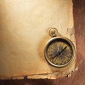Fotografie Vintage compass on old paper