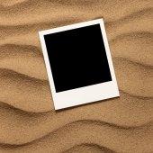 Fotografia portafoto su fondo sabbia