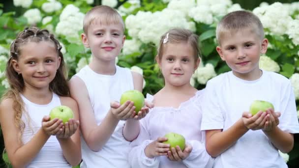 Boys and girls hold apples
