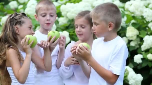 Boys and girls eat apples