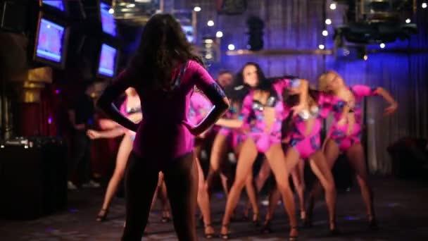 dancing showgirls in costumes