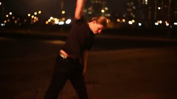 Young man juggles with burning mace