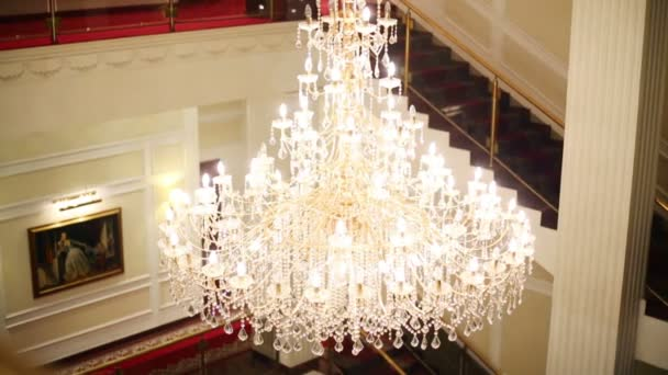 Large crystal chandelier in hall