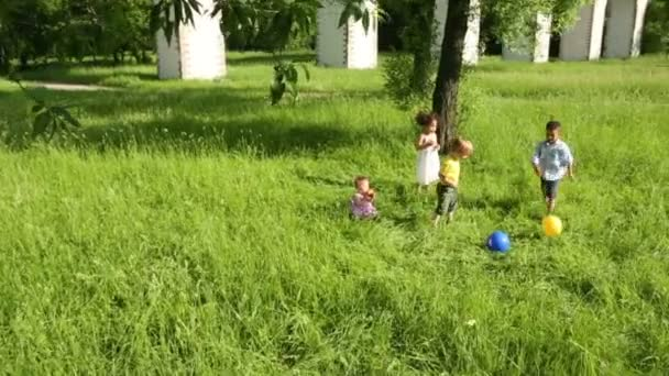 Four little kids play with ball
