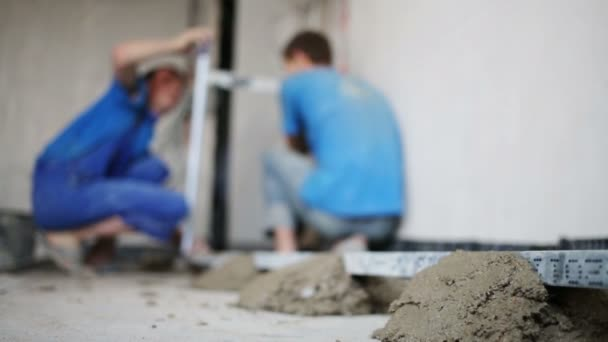 Workers makes measurements for pouring floor.