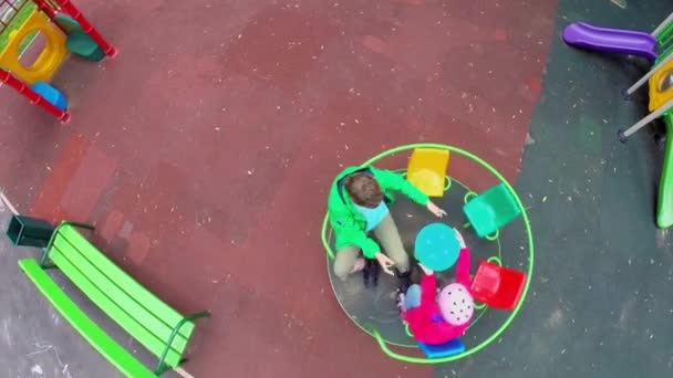 Kids circling at carousel on playground