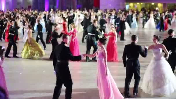 Girls in colored dresses dancing with guys