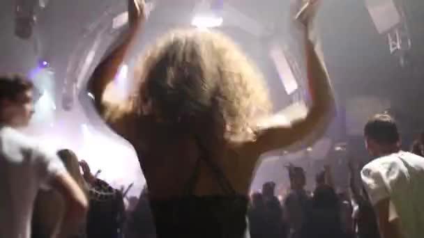 woman dancing in crowd