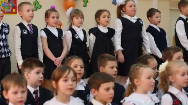 Children sing at holiday of Alphabet
