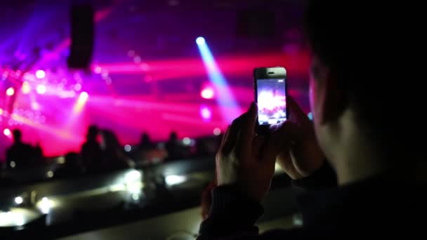 Man shoots laser show and silhouettes of people by phone