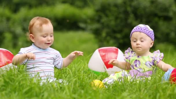 Babies play on of meadow