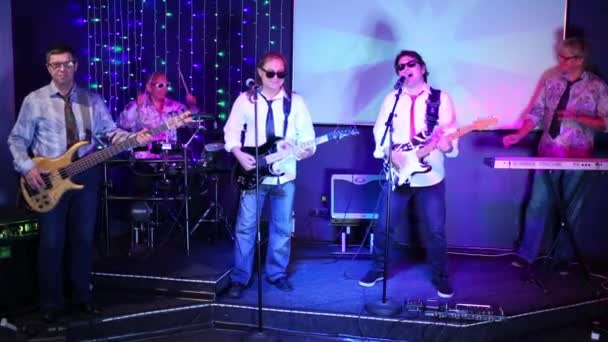 Musical group performs on stage