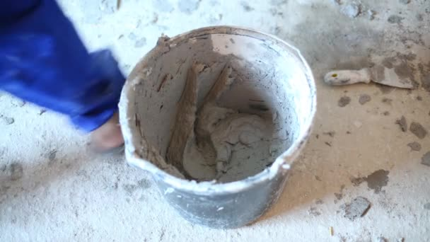 Hands on man taking by trowel mortar for plaster walls