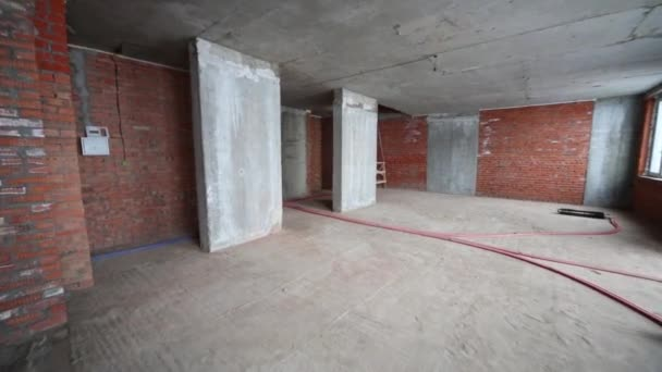 Apartment with concrete floor in building under construction
