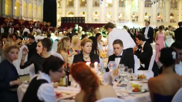 People eat at 11th Viennese Ball in Gostiny Dvor