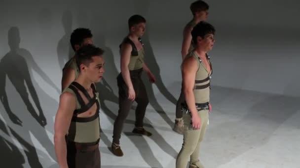 Above view of five men in hunting costumes dancing in studio