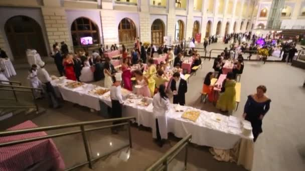 People eat in canteen at 11th Viennese Ball in Gostiny Dvor