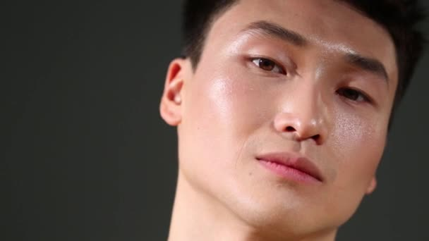 Close up portrait of handsome young asian smiling man