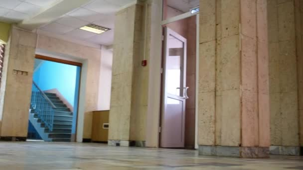 Floor and white repoussage doors of entrance of building