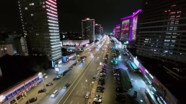 Cars drive by New Arbat street with illumination at night