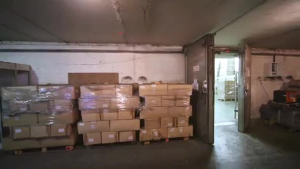 The long room of warehouse filled with boxes and pallets