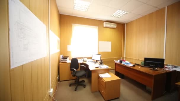 Office room with computers and papers on the desktop