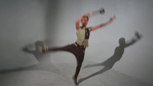 Handsome young man in medieval costume dances with mace