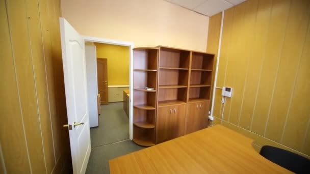 Two small office rooms with empty workplaces and cabinets