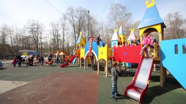 Children play on playground in Sokolniki park in sunny day