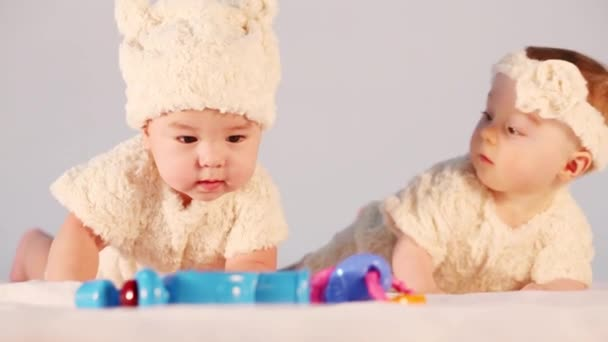 Two babies dressed in fur costumes