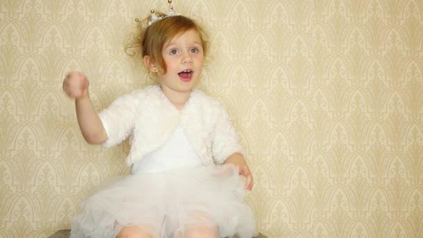 Little girl wearing a crown a