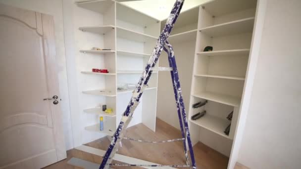 Room with stepladder and slide wardrobe