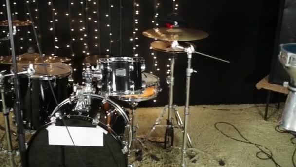 Studio room with keyboard, drum set