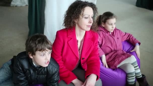 Woman and children look to window