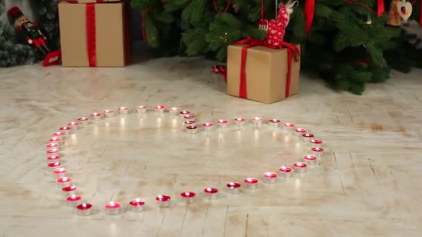 Many small candles in shape of heart