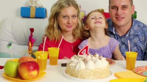 Little girl at birthday table