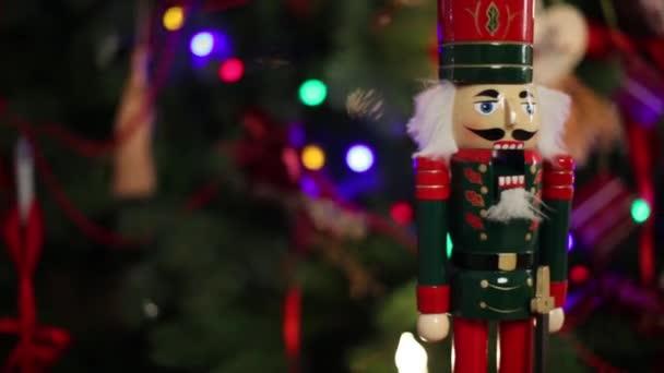 Toy Nutcracker and illuminated garland