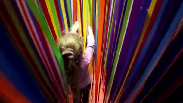 Little girl wades through ribbons