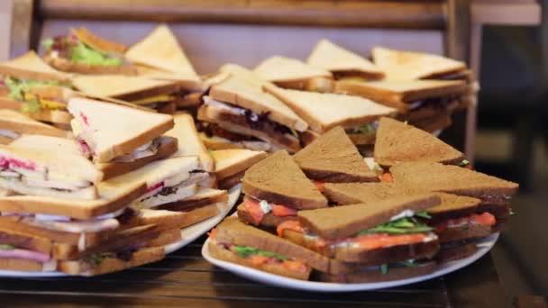 Triangular sandwiches on table