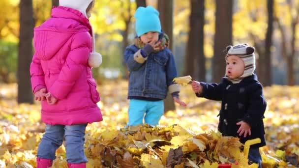 Three happy children play in park