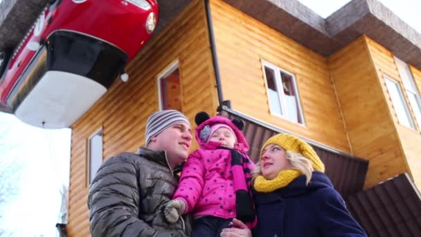 Family near roof of real inverted house